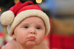 Santa Baby FAce. Serious Baby Girl in santa outfit for christmas Stock Photography