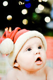Santa Baby FAce Amazed. Amazed Faced Baby Girl in santa outfit for christmas Royalty Free Stock Photos
