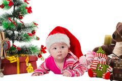 Santa baby girl near Christmas tree and gift Stock Images