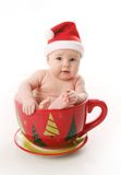 Santa baby in a large mug Royalty Free Stock Photo