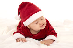 Santa baby lay on belly eyes closed Stock Photography