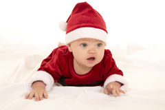 Santa baby lay on belly look Stock Image