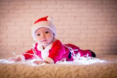 Santa baby and ligths royalty free stock photography