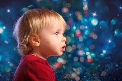 Santa baby looking fascinated sideways Stock Image