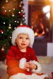 Santa baby with santa hat stock photos