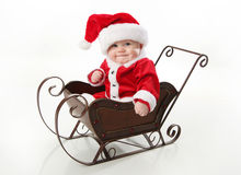 Santa baby sitting in a sleigh Stock Photos