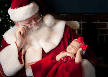 Santa and baby sleeping Stock Photo