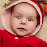 Santa babygirl. Little santa newborn baby girl Royalty Free Stock Image
