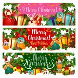 Santa bag with Christmas and New Year gift banner. Present with ribbon bow, candy and toy greeting card, decorated with Xmas tree and holly berry, star garland Royalty Free Stock Image