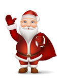 Santa with a bag of gifts behind the back waving his hand Stock Photo