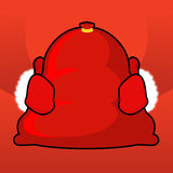 Santa bag and red mittens. Big sack with gifts. Giving gifts at Royalty Free Stock Photos