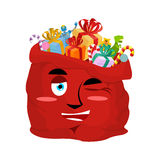 Santa bag winks Emoji. Christmas sack with gifts merry emotion. Royalty Free Stock Photos