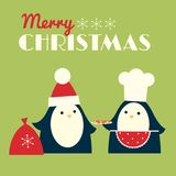 Santa and baker penguins Royalty Free Stock Image