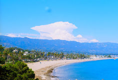 Santa Barbara, California beach & foothills (film). Santa Barbara, California ocean and foothills sunny day with thoundercloud, film image Royalty Free Stock Photo