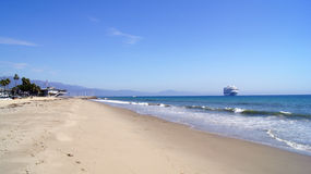 SANTA BARBARA, CALIFORNIA, USA - OCT 8th, 2014: city Leadbetter beach with a cruise liner royalty free stock photography
