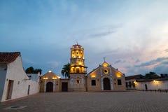 Santa Barbara Church. Evening lights come on at the Santa Barbara Church at dusk in Mompox, Colombia Stock Photos