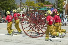 Santa Barbara Fire Department pulling old fire engine during opening day parade down State Street, Santa Barbara, CA, Old Spanish  Royalty Free Stock Photos