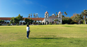 Santa Barbara Mission from a Distance. With a woman shooting pictures in the front Stock Image