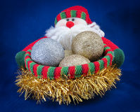 Santa Basket. Knitted Santa with decorations in a basket Stock Images