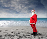 Santa beach. Funny santa claus standing on the beach Stock Photos