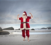 Santa at the beach Royalty Free Stock Photography
