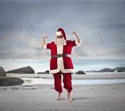 Santa at the beach royalty free stock photography