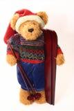 Santa Bear. Teddy bear with santa hat ready to ski royalty free stock photos
