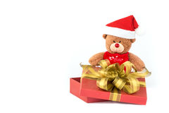 Santa bear in  gift box. Santa teddy bear in red gift box with golden ribbon Royalty Free Stock Photography