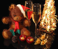 Santa Bear with a glass of champagne on background. Shining light Royalty Free Stock Photography