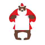 Santa bear keep clean banner with space for text.. Wild animal with beard and moustache. Woodland Beast in clothes of Santa Claus: red jacket and Christmas hat Royalty Free Stock Photo