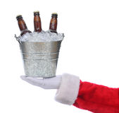 Santa with beer bucket. Santa Claus outstretched arm holding a bucket of beer in his hand. Square format over a white background Royalty Free Stock Photography