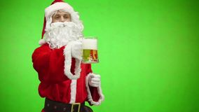 Santa with a beer glass. Santa Claus holding a drink. Funny Christmas toasts. Chromakey