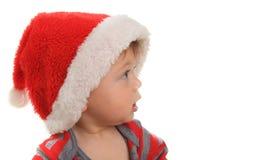 Santa behandla som ett barn Arkivbild