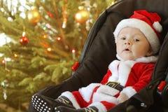 Santa behandla som ett barn Arkivfoton