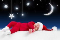 Santa behandla som ett barn Arkivbilder