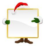 Santa behind Christmas sign Royalty Free Stock Photography