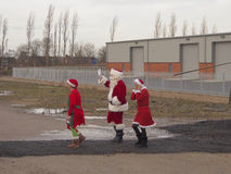 Santa being escorted Stock Photography