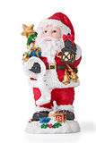 Santa with bells carring presents. Isolated Stock Photo