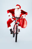 Santa on bicycle Stock Photo