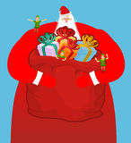 Santa with big bag of gifts. Red sack with toys and sweets. Chri Royalty Free Stock Photos