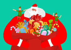 Santa with big bag of gifts. Red sack with toys and sweets. Chri Stock Photography