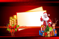 Santa with a big christmas cards with candles Royalty Free Stock Images