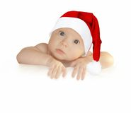 Santa-blank-oops. Cute baby girl in Christmas hat holding empty blank board Stock Image