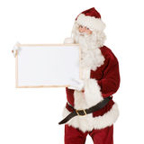Santa with blank sign Stock Images