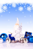 Santa on blue background with snowflakes. Cute santa claus figure with christmas balls on gradiant background with snowflakes Royalty Free Stock Photo