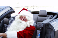 Santa in blue convertible Royalty Free Stock Images