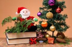 Santa on a book Stock Photos