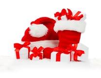 Santa Boot, cappuccio e regali immagini stock