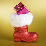 Santa Boot with Gift Royalty Free Stock Photos