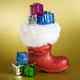 Santa Boot with Gifts Stock Image